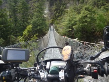 Crossing a footbridge, near Manang, Nepal