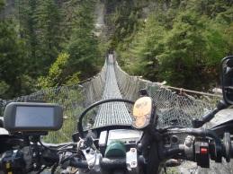 Crossing a footbridge, near Manang, Nepal